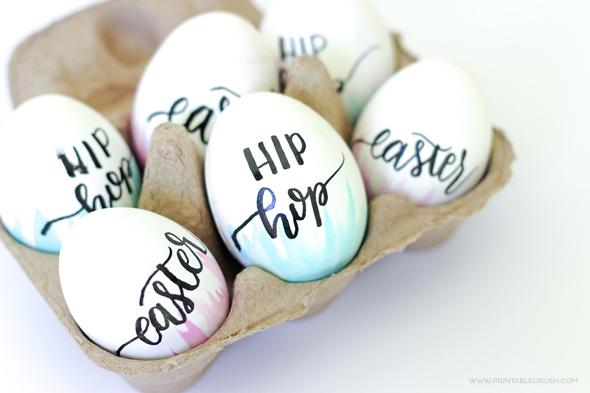 Learn how to Make Hand Lettered and Watercolor Easter Eggs for a unique take on this fun craft. It's so easy, you can create these with the kids, too!