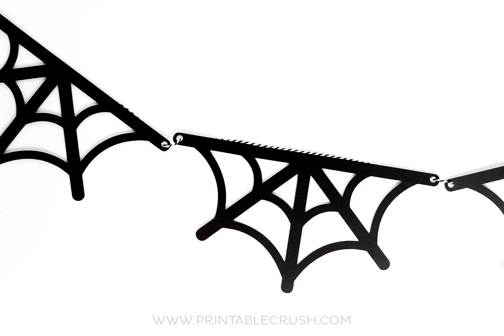 This FREE Spider Web Banner SVG File is such an easy craft. Use it for your Halloween Mantel decor, party decor, and more!